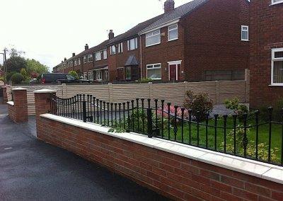 Brick wall with railings