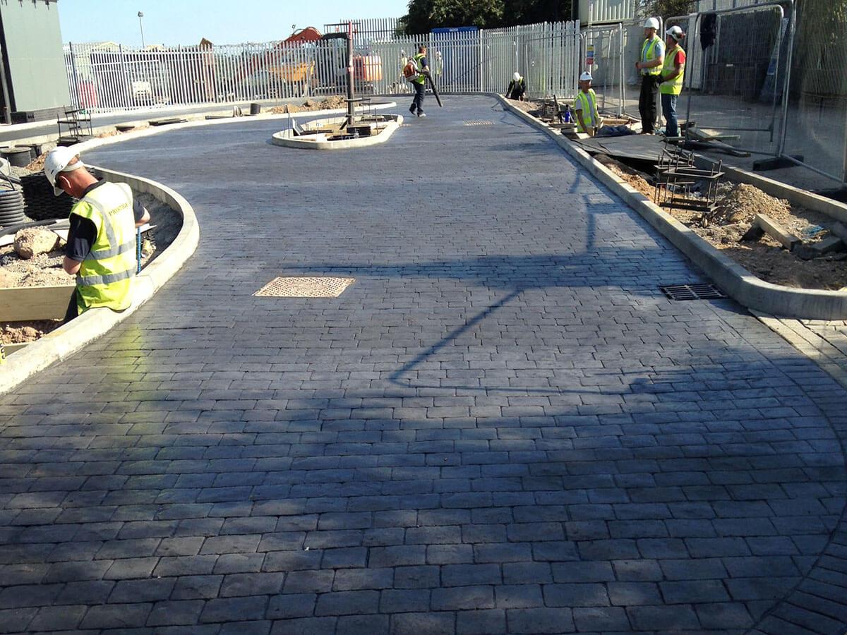 Charcoal-imprinted-concrete-drive-thru-lane