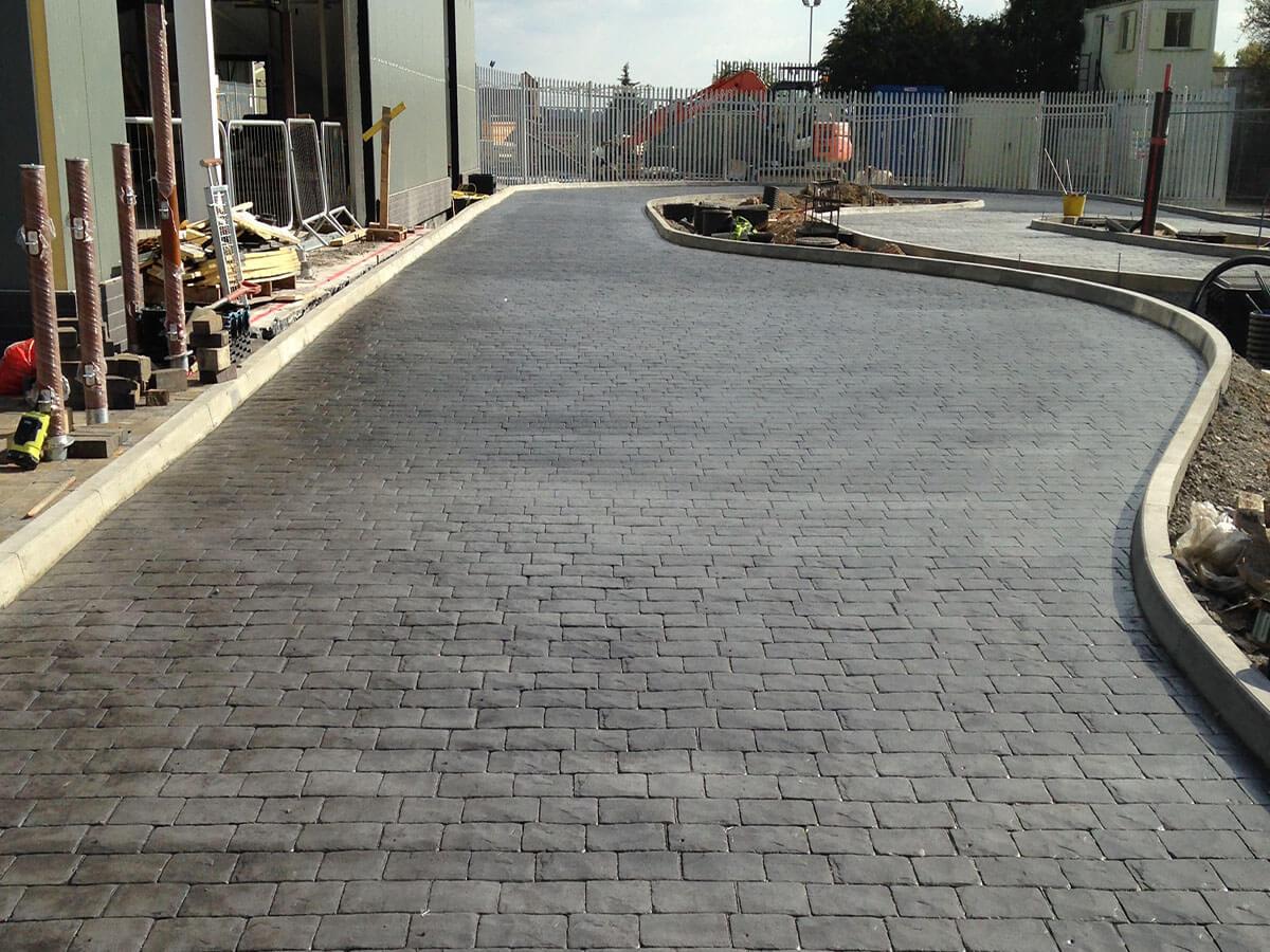 Concrete-imprint-cobbles-charcoal-colour-through